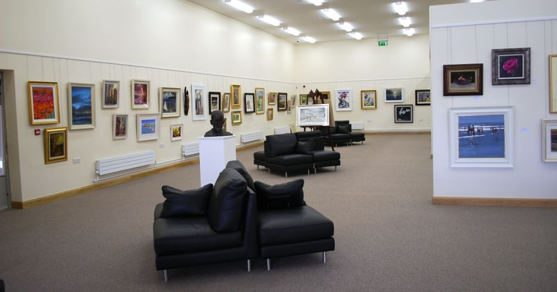Nora Dunne Gallery with paintings on hanging system (2)
